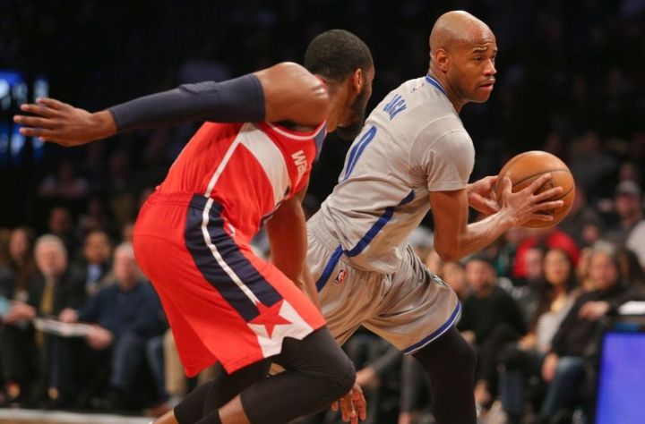 John Wall guards Jarrett Jack