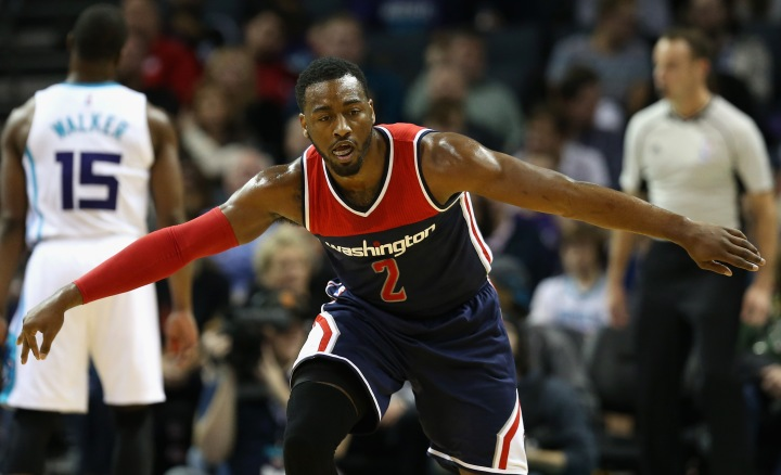 CHARLOTTE, NC - NOVEMBER 25: John Wall #2 of the Washington Wizards reacts after making a basket against the Charlotte Hornets during their game at Time Warner Cable Arena on November 25, 2015 in Charlotte, North Carolina. NBA - NOTE TO USER: User expressly acknowledges and agrees that, by downloading and or using this photograph, User is consenting to the terms and conditions of the Getty Images License Agreement. (Photo by Streeter Lecka/Getty Images)
